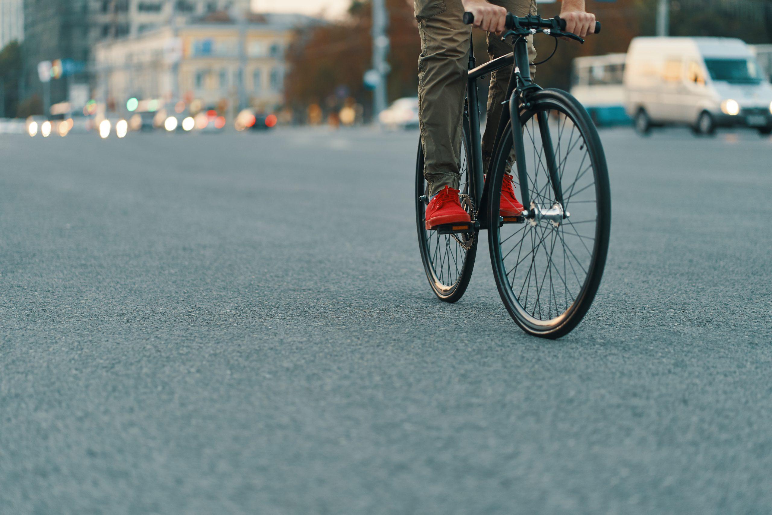 Closeup of casual man legs riding classic bike on city road   Muslim Cyclists   AICC